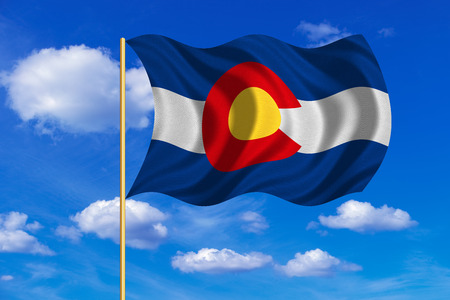 Flag of the US state of Colorado. American patriotic element. USA banner. United States of America symbol. Colorado official flag on flagpole waving in the wind, blue sky background. Fabric texture