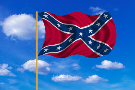battle cross: Historical national flag of the Confederate States of America. Known as Confederate Battle, Rebel, Southern Cross, Dixie flag. Patriotic symbol, banner. Flag of the CSA waving in the wind, blue sky Stock Photo