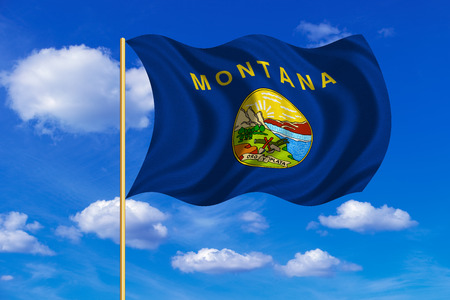 flagstaff: Flag of the US state of Montana. American patriotic element. USA banner. United States of America symbol. Montanan official flag on flagpole waving in the wind, blue sky background. Fabric texture