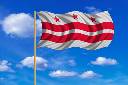 Flag of the District of Columbia. American patriotic element. USA banner. United States of America symbol. Washington, D.C. official flag on flagpole waving in the wind, sky background. Fabric texture Stock Photo