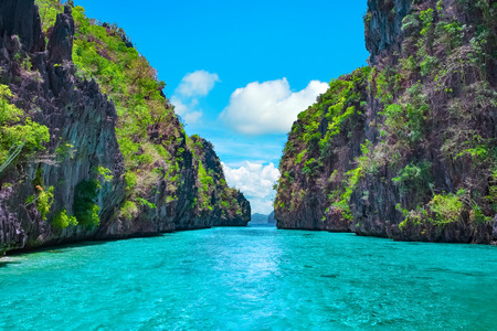 Beautiful tropical blue lagoon. Scenic landscape with sea bay and mountain islands, El Nido, Palawan, Philippines, Southeast Asia. Exotic scenery. Popular landmark, famous destination of Philippines 스톡 콘텐츠