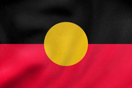 Australian Aboriginal official flag. Commonwealth of Australia patriotic symbol, banner, element, background. Correct colors. Australian Aboriginal flag waving in wind, fabric texture. 3D illustration