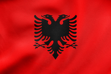 Albanian national official flag. Patriotic symbol, banner, element, background. Correct colors. Flag of Albania waving in the wind, real detailed fabric texture. 3D illustration Stock Photo