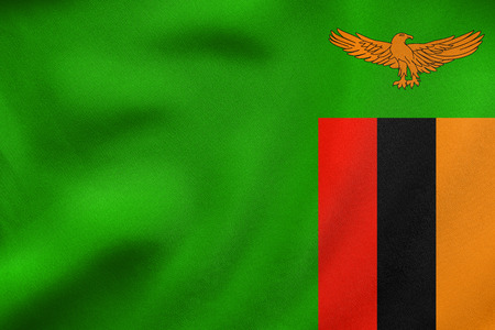 Zambian national official flag. African patriotic symbol, banner, element, background. Correct colors. Flag of Zambia waving in the wind, real detailed fabric texture. 3D illustration Stock Photo