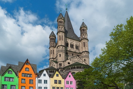Old houses, St. Martin Church, Cologne, Germany. Facade of colorful buildings in Cologne old town on Rhine river embankment. Beautiful european architecture, North Rhine-Westphalia, Rhineland, Europe