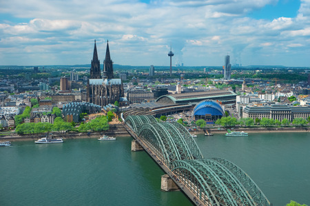 Skyline of Cologne with Cathedral, Germany, Europe. Famous most visited place, symbol of Cologne. Beautiful european architecture. Aerial view of Cologne Cathedral, Rhine river and Hohenzollern Bridge Stock Photo