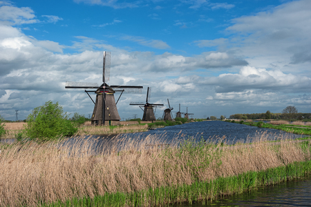 Traditional dutch windmills and water canal, Kinderdijk, Netherlands, Benelux, Europe. Typical old dutch mill, scenery. Beautiful rural landscape. Famous village Kinderdijk.