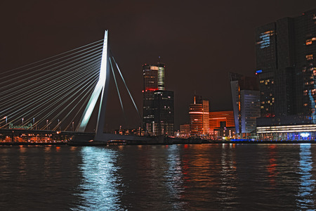 Rotterdam skyline with Erasmus bridge at night, Netherlands, Europe. Cityscape at dusk. Skyscrapers and bridge over the river Meuse in city centre at twilight, Rotterdam, South Holland province