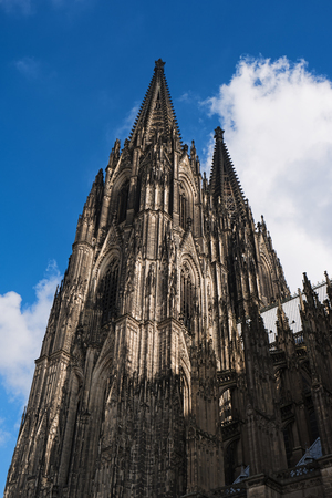 Cologne Cathedral on blue sky background, Germany, Europe. Famous monument and most visited place, symbol of Cologne. Beautiful european architecture. Roman Catholic gothic cathedral.