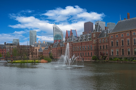 City center of The Hague, Netherlands, Europe. Binnenhof palace in Den Haag. The Dutch Parliament and Hofvijer Pond. Cityscape of The Hague. Skyline, old and new buildings, skyscrapers on background