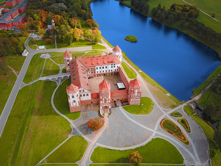 Mir Castle Complex, Belarus, Europe. Aerial view of famous belarusian medieval castle. Historic building in autumn. Symbol of belorussian architecture. Cityscape of Mir. Birds eye panorama