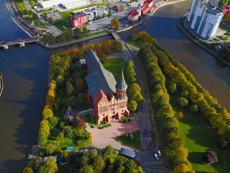 Aerial cityscape of Kaliningrad, Russia. Gothic cathedral in Kaliningrad city, formerly Koenigsberg, Germany. Beautiful view of Kant Island. The center of city in autumn. Birds eye panorama