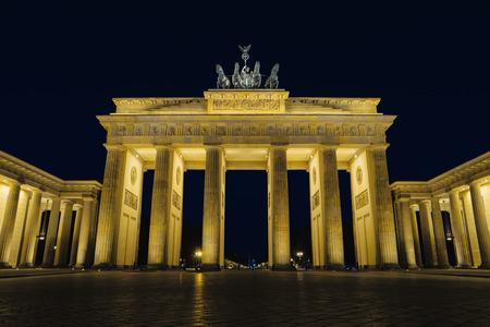 Brandenburg gate at night, Berlin, Germany, Europe. Beautiful german architecture. Brandenburger Tor with night illumination. Popular landmark in centre of Berlin. Famous travel destination of Germany