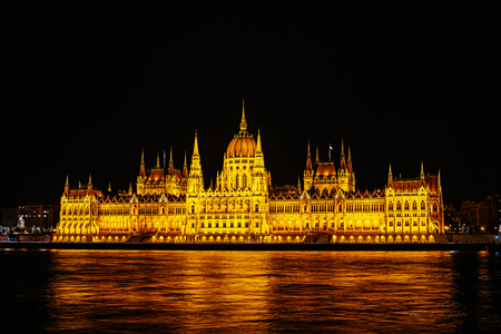Hungarian Parliament Building, Budapest, Hungary. Seat of National Assembly of Hungary. Night view of House of Parliament. Famous landmark of Hungary, popular tourist destination of Budapest on Danube