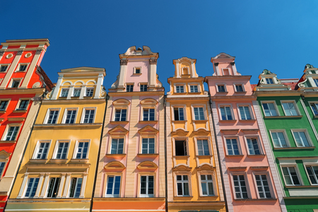 Colorful houses on Market square, Wroclaw, Poland. Townhouses in medieval market square, rynek. City centre, ancient homes. Tenement houses, popular landmark. Famous Wroclaw Old Town, Lower Silesia