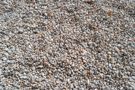 Pebbles on the beach for texture and background. Sea stones, Atlantic coast, Etretat, Normandy, France, Europe. Beautiful round sea pebbles on pebble beach, closeup