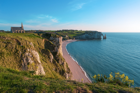 Beach, ocean and cliffs, Etretat, Normandy, France, Europe. Natural arches, white chalk cliffs over Atlantic Ocean. Sea bay, landscape Popular landmark famous destination. Aerial view of Etretat beach
