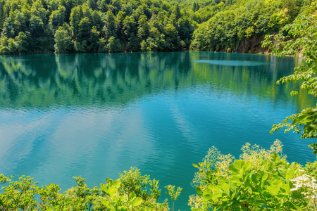 Plitvice Lakes National Park, Croatia, Europe. Natural park with waterfalls and turquoise water.  Blue clear water of Plitvicka Jezera. View of lake. Summer landscape