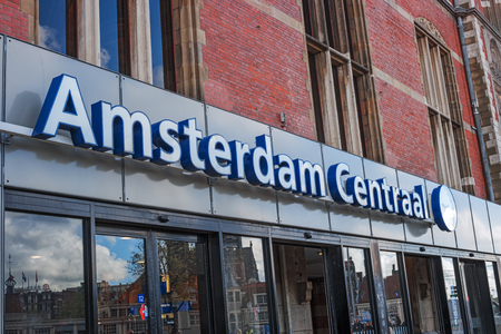 Amsterdam, Netherlands, April 18, 2017: Entrance to Amsterdam Central railway station. Amsterdam Centraal Station is largest main train station, national railway hub, public transport transfer spot