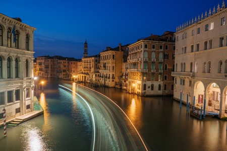 Venice at night, Italy, Europe. Grand Canal, old buildings. Water street, historic houses. Traditional italian tenements on channel. Famous travel destination, landmark. Venice with night illumination