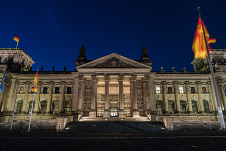 German Reichstag building at night, Mitte, Berlin, Germany, Europe. Reichstag or Bundestag is German federal parliament. Popular landmark, famous travel destination, historic edifice in Berlin city