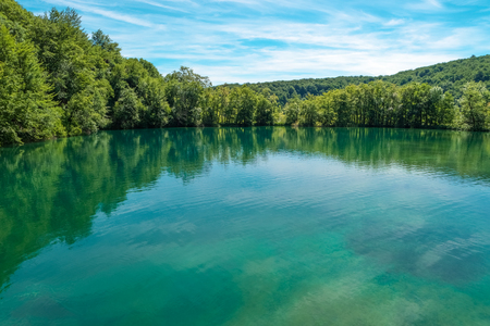 Plitvice Lakes National Park, Croatia, Europe. Natural park. Scenic nature. Lake with turquoise water. View of Plitvicka Jezera. Natural scenery. Adventure ecological tourism concept. Summer landscape