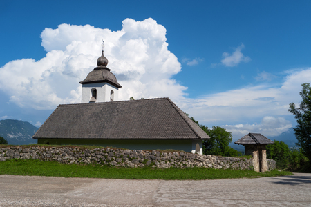 Church of St. Catherine, Zasip, Slovenia, Europe. Typical small historic ancient country mountain Saint Catherine church, slovenian Alps. Mountain slovenian landscape, Julian Alps, near Bled, Slovenia