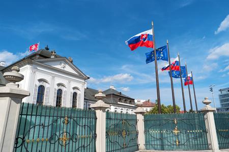 Grassalkovich Palace, Bratislava, Europe. Residence of the president of Slovakia in Bratislava. Grassalkovich Presidential Palace. Slovakian and EU flags. National flags of Slovakia and European Union
