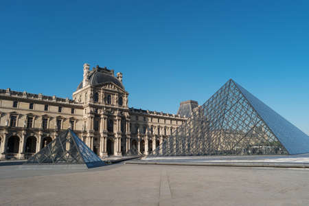 Paris, France, April 27, 2017: Louvre Museum, building and pyramid, France, Europe. Louvre Museum is one of largest and most visited museums worldwide, historic monument, central landmark of Paris