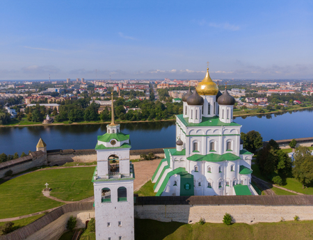 Trinity Cathedral, Kremlin in Pskov, Russia, Europe. Aerial view of Pskov Kremlin and Trinity Cathedral church in russian city. Panorama of city, cityscape. Embankment of Velikaya river. Famous place
