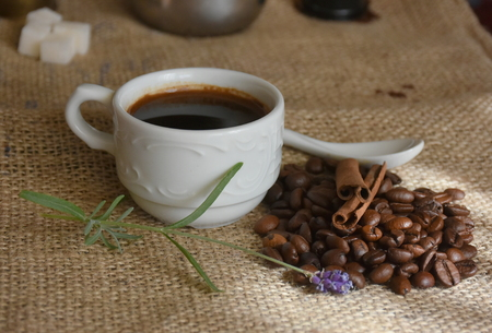 Coffee beans and coffee cup on jute canvas Stock Photo