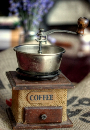 Old coffee grinder on jute canvas Stock Photo