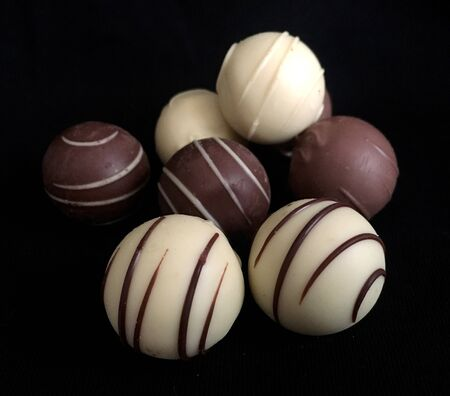Sweet chocolate balls on a black background