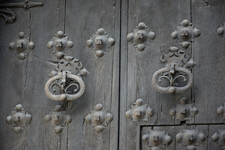 Old wooden door with metallic details