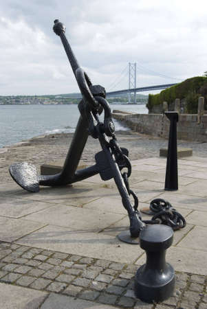 forth: a vertical image of a ships anchor with the Forth Road Bridge in the background Stock Photo
