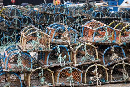 quayside: a horizontal image of lobster creels stacked on the quayside