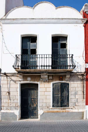 a vertical image of an old dilapidated spanish style building with cracked and peeling paint Stock Photo - 7485328