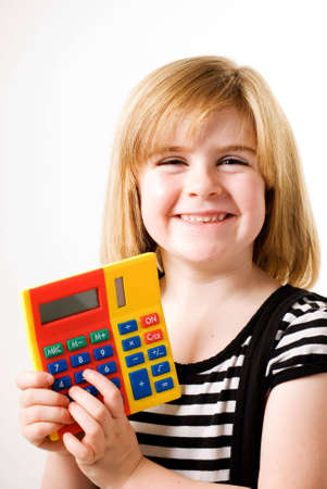 femal: a vertical image of a young femal showing her answers on a brightly coloured calculator
