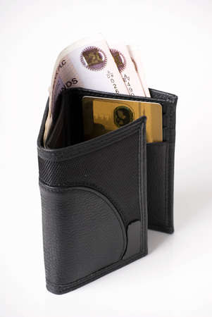 a vertical image of a gents black leather wallet open and showing money and a gold credit card photo