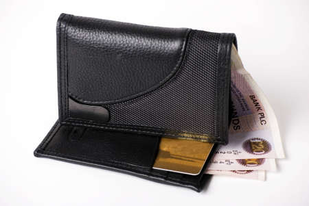 gents: a horizontal image of a gents black leather wallet with gold credit card and money showing