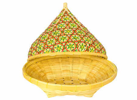 Bamboo basket with open lid isolated on white background photo