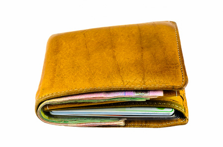 Brown old leather wallet isolated on white background photo