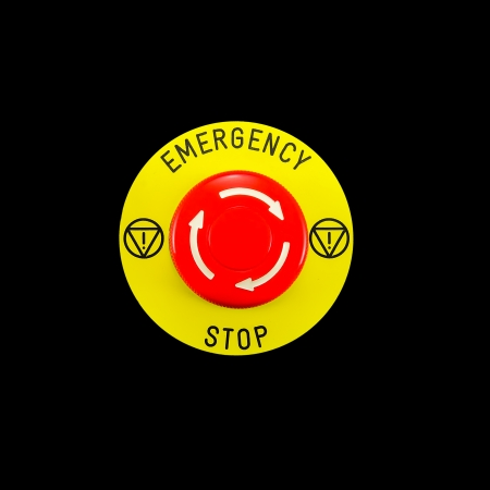 Red emergency button switch isolated on black background photo
