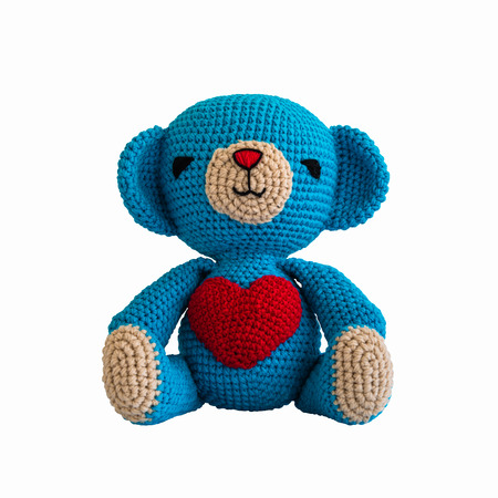 handmade crochet blue bear doll isolated on white background photo