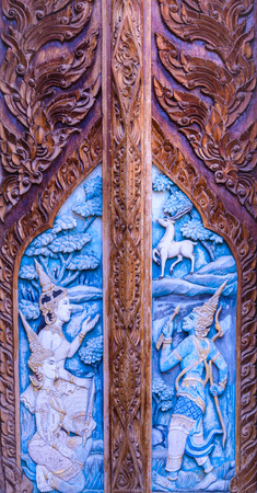Gate made of wood carved with the delicate and beautiful photo