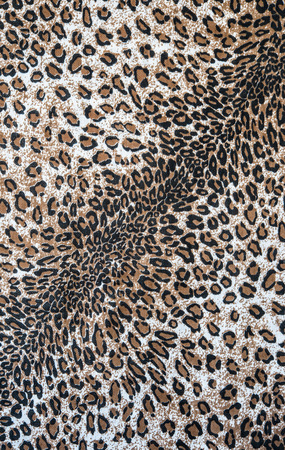 mottle: The fabric on striped leopard on background