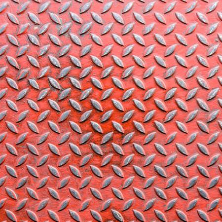 diamondplate: old red diamond metal sheet on background