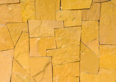 yellow stone: Pared de piedra amarilla en el fondo Foto de archivo