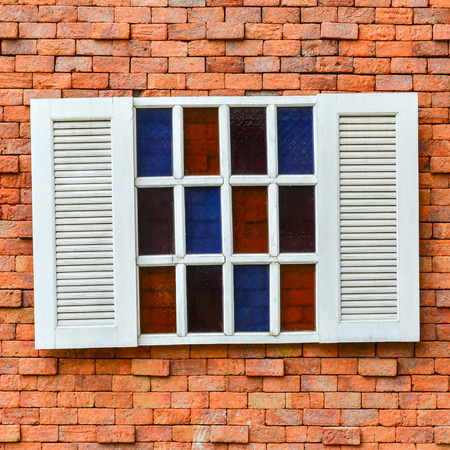 white window: white window on red brick wall for background Stock Photo