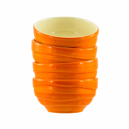 orange ceramic bowls isolated on white background photo